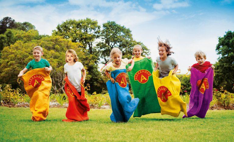 Children having a sack race in park